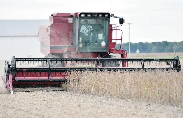 Bill Rethman, of Fort Loramie, harvests soybeans in a field next to Greenback Road in Fort Loramie Wednesday, Oct. 10. Farmers dodged rain throughout the day as harvest season continues.