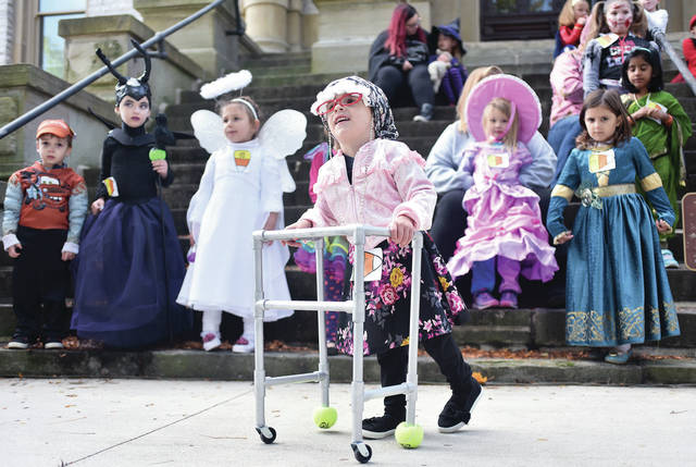 Branson Woolley, 4, of Sidney, son of Ashley Walker and Brian Woolley, came dressed as a little old lady for Sidney Alives's Fall Festival costume contest Saturday, Oct. 13. The contest was held on the courthouse steps.