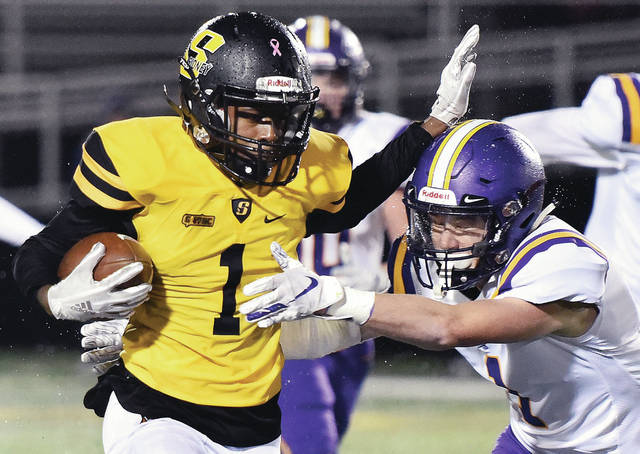 Sidney freshman wide receiver Quamir Brown pushes away Vandalia-Butler's Gavin Casella at Sidney during a Greater Western Ohio Conference American North Division game on Friday at Sidney Memorial Stadium.