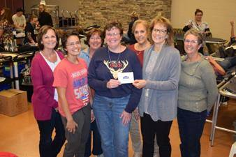 CBC's Kathy Pleiman, second from right, and Fort Loramie Community Service Club blood drive volunteers present a $5,000 home improvement gift card to Sharon Holdheide, center, and her daughter Emily, second from left.