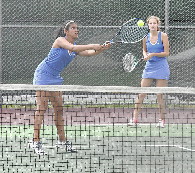 Lehman's Ann Pannapara volleys at the net as Keira Burns looks on Tuesday.
