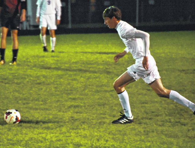 Lehman Catholic's Conor O'Leary moves towards the ball during a Division III sectional opener at Middletown Madison on Monday.