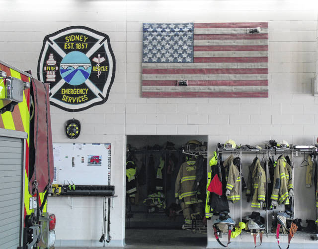 An American flag made from discarded fire hoses hangs in the Sidney Fire Department's Station 1. It was made by Sidney Firefighter Chance Guisinger and other members of the C fire crew.