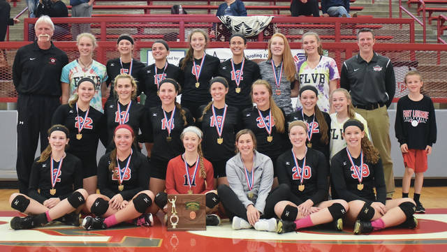 Fort Loramie's players and coaches pose with their Division IV district championship trophy following a 3-0 win over Lehman Catholic on Saturday in Troy.