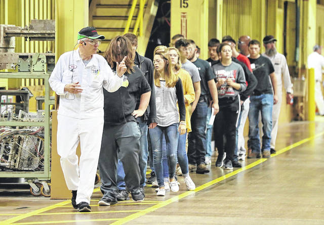 Honda associate Rick Vangundy leads students through the Anna Engine Plant during Honda's Manufacturing Day events.