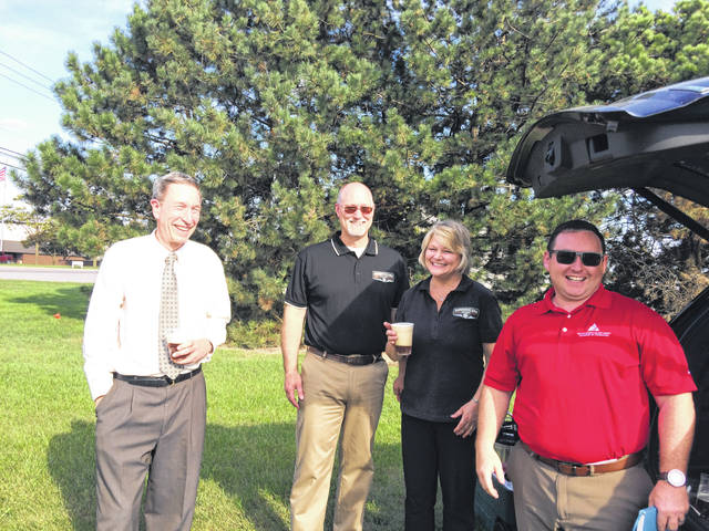 Bill Wente, First National Bank president, left to right, GonGoozlers principles James Gilberg and Diane Gilberg and Logan O'Neill, Southwestern Auglaize County Chamber of Commerce executive director, visit Monday afternoon during groundbreaking ceremony for the new brewery to be built in New Bremen.