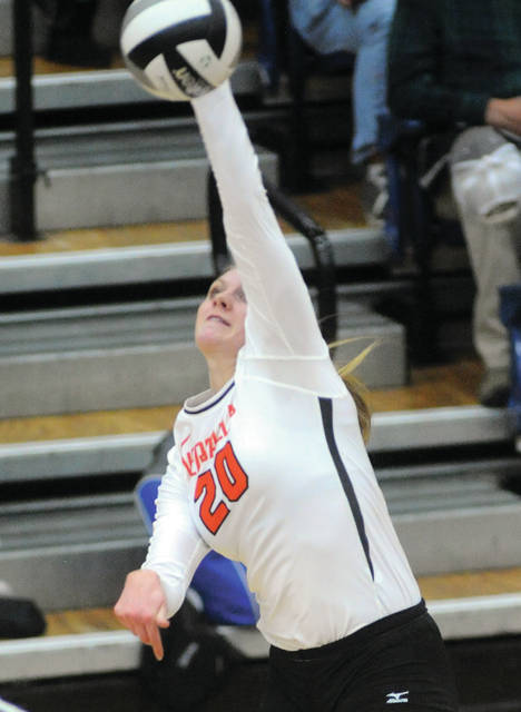 Versailles' Liz Ording spikes during a Division III regional semifinal against Miami East on Thursday at Trent Arena in Kettering.