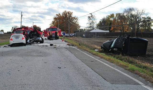 First responders from Piqua, Fletcher, Sidney, and the Miami County Sheriff's Office investigate a three-vehicle crash on County Road 25-A at Troy-Sidney Road, north of Piqua, on Tuesday afternoon.
