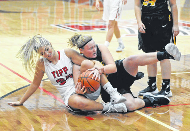 Sidney senior center Emma Wiford, right, fights for the ball with Tippecanoe's Katie Salyer uring a Greater Western Ohio Conference American North Division game on Wednesday in Tipp City.
