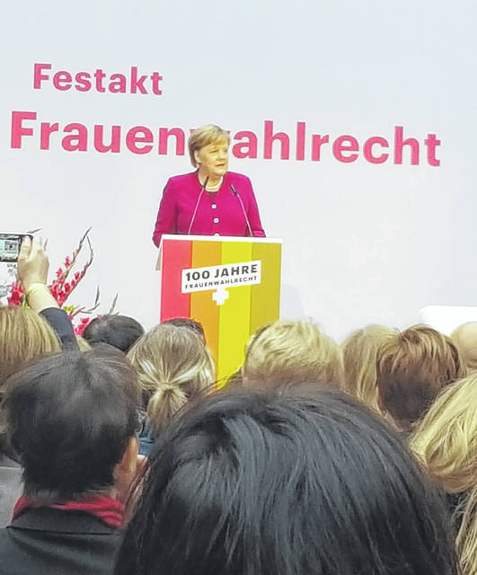 German Chancellor Dr. Angela Merkel speaks at a celebration of the 100th anniversary of women's suffrage in her country, Monday, Nov. 12, in Berlin. Shelby County Commissioner Julie Ehemann was in the audience.