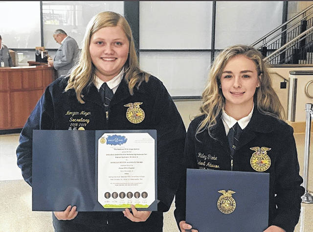 Morgan Meyer, left, and Riley Thobe placed second overall in animal systems in the National FFA Agriscience Fair.