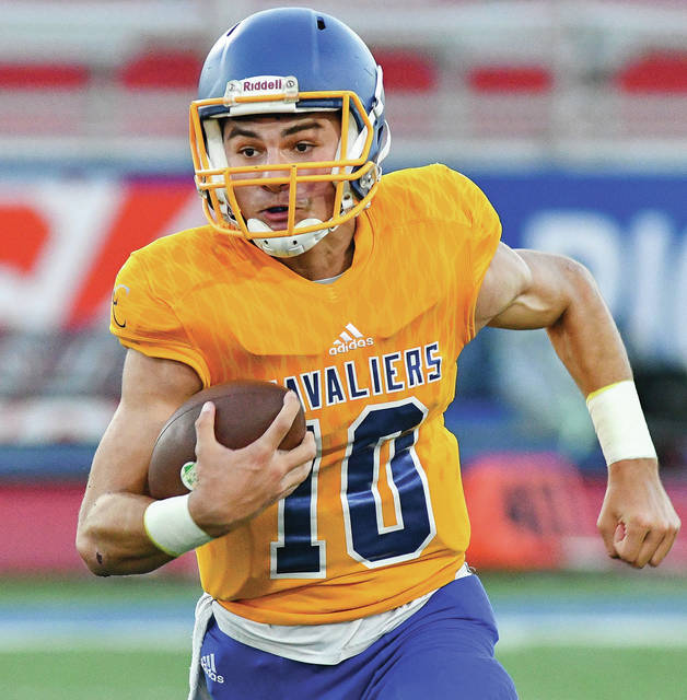 Lehman Catholic senior quarterback Elliott Gilardi runs during a Northwest Central Conference game against Ridgemont on Sept. 15 at Alexander Stadium in Piqua. Gilardi was named the NWCC offensive player of the year earlier this week.