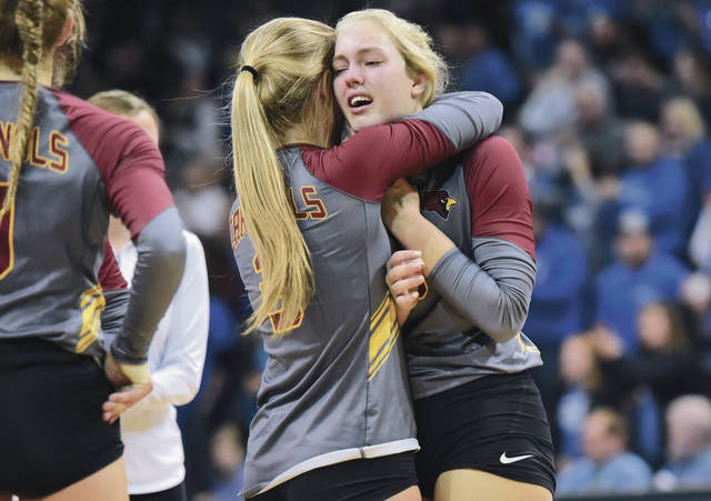 New Bremen's Diana Heitkamp, left, gives Ashton Heitkamp a hug after falling to Tiffin Calvert in the Division IV state final on Saturday at Wright State's Nutter Center in Fairborn.