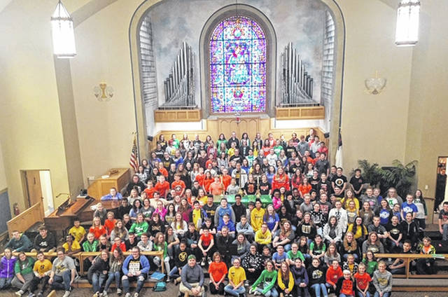 Junior high school choirs from Anna, Botkins, Fairlawn, Jackson Center and Sidney middle schools pose for a photo in the Sidney First United Methodist Church, Tuesday, Nov. 6, during the day-long Shelby County Junior High Choral Festival. The student choirs rehearsed with choral clinicians Frank Fahrer, Deb Bringman, David Weimer, Frida Maxson and David Schneider to improve their technique, blend, balance, tone and support.