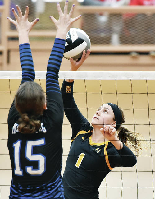 Sidney's Alina Kindle spikes as Miamisburg's Kaitlyn Whitesell defends during a sectional tournament match on Oct. 20 at Vandalia-Butler's Student Activities Center. Kindle was named second team all-GWOC American League.