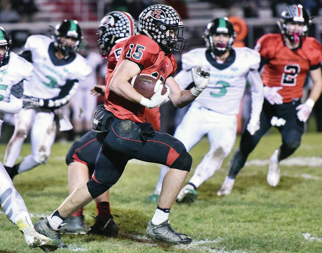 Fort Loramie's Mark Seger runs during a Division VII regional quarterfinal against New Miami on Saturday in Fort Loramie.