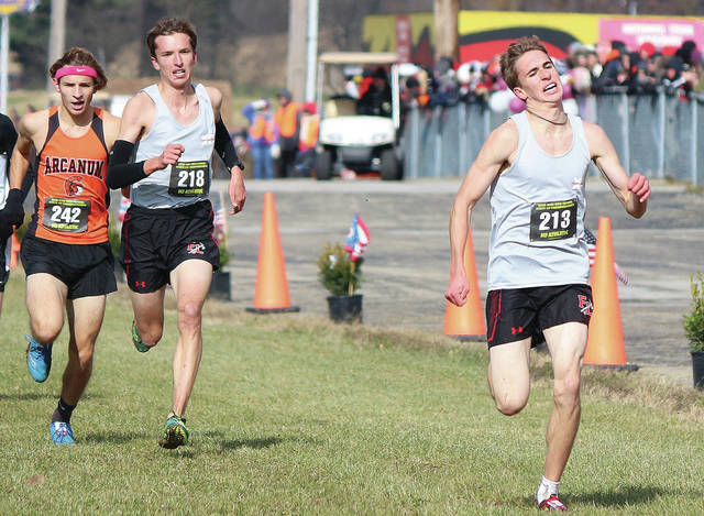 Fort Loramie's Joe Ballas (213) and Jake Rethman (218) run during the Division III state cross country race on Saturday at National Trail Raceway in Hebron. Ballas finished third and Rethman finished fifth to lead the Redskins to the D-III state cross country title.