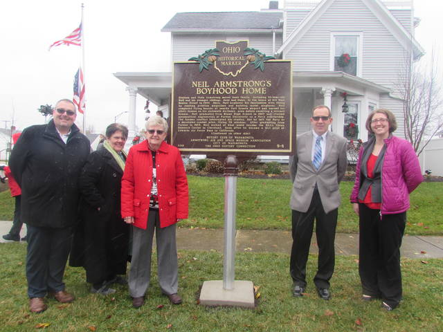 From left standing next to a historical marker in front of Neil Armstrong's boyhood home are Josh Little, Wapakoneta Rotary Club president, Rachel Barber, 2019 celebration committee member, Karen Tullis, homeowner, Tom Stinebaugh, Wapakoneta mayor and Brittany Venturella, Armstrong Musuem interim director and curator.