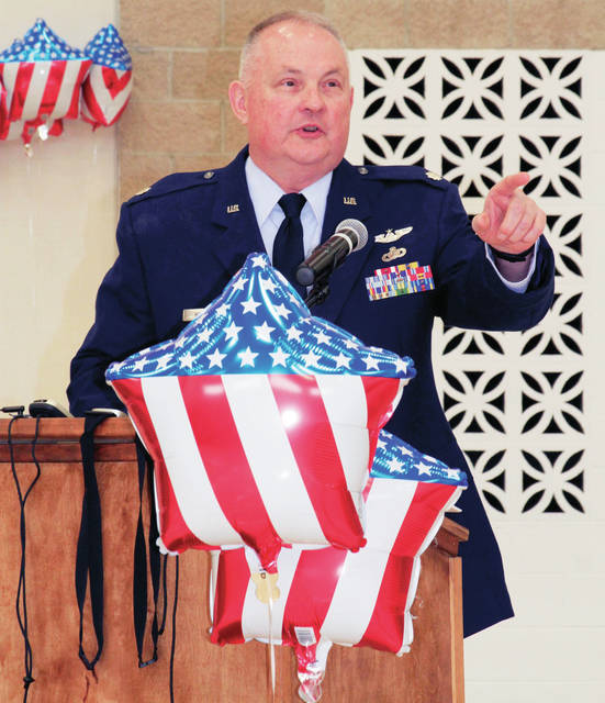 Retired U.S. Air Force Lt. Col. Dan Bratka, of West Liberty, addresses an enthusiastic crowd at the Jackson Center High School during a Veterans Day breakfast sponsored by the, FCCLA Friday morning, Nov. 9.