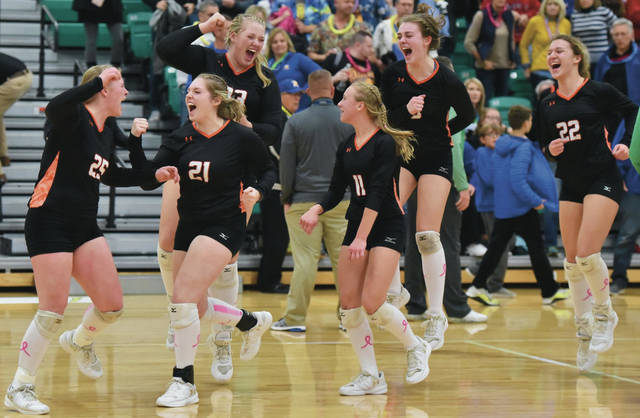 Jackson Center's players celebrate after scoring the final point in a Division IV regional semifinal against Russia on Thursday at Northmont's Thunderdome.