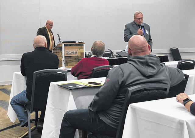 Retired SCS Superintendent John Scheu, top left, and Shelby County Sheriff John Lenhart, top right, present Shelby County and Sidney City Schools's security plan at the 2018 Ohio School Board Association Capital Conference and Trade Show in Greater Columbus Convention Center on Nov. 13.