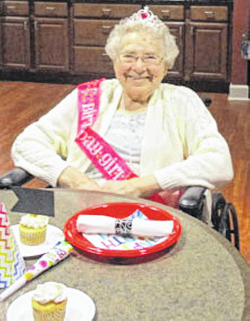 Leona Tuente, of New Bremen, celebrates her 100th birthday, Nov. 11, 2018, at Elmwood Assisted Living. Her family joined her for a meal and birthday cupcakes in Elmwood's Cardinal Corner.