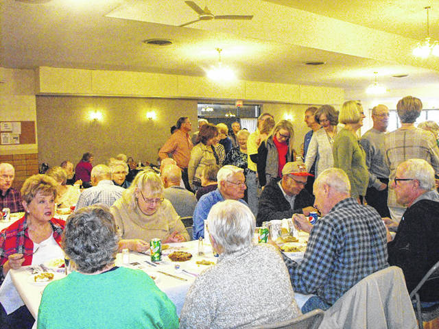 Area residents enjoy the 2017 Thanksgiving Fellowship at the Minster Knights of Columbus hall. This year's dinner will be Nov. 22.