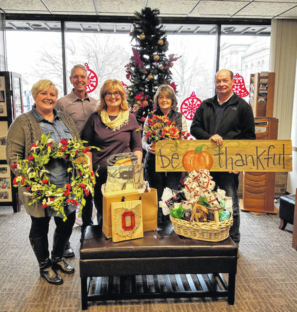 Linda Boyer, second from right, and her husband, Rich, far right, of Sidney, display the Shop Hop grand prize they won recently. Also pictured are Amy Breinich, left to right, director of Sidney Alive; Jeff Raible, president of the Sidney-Shelby County Chamber of Commerce, and Darla Cabe, coordinator of the Angels in the Attic craft show.
