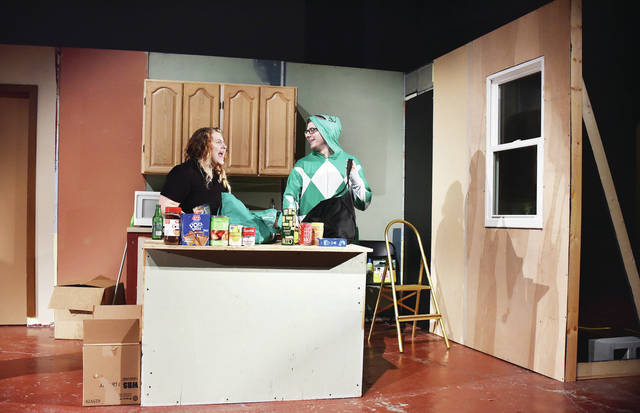 """Polly Lawson, left, of Sidney, playing the part of Olivia, unloads groceries with T.J Montgomery, of Dayton, playing the part of Gabe, during a rehearsal of a """"Things My Mother Taught Me,"""" a play to be produced in the Historic Sidney Theatre by Sock and Buskin Players. It opens Nov. 9."""