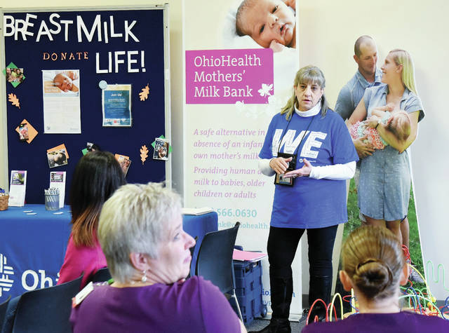 Chris Smith, RN, Columbus, explains the Milk Bank program to interested mothers and friends.