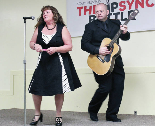"Jenny Riffell Landers, left, of Rosewood, and Warren Melerine, of Sidney, perform ""Jackson"" by Johny Cash during Shelby County Animal Rescue Foundation's (SCARF) ""The Lip Sync Battle."" The SCARF fundraiser featured local people pretending to sing to music at the Sidney American Legion Saturday, Nov. 10."