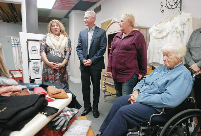 Misty Reese, left, to right, of Jackson Center, speaks during a ribbon cutting ceremony for her store Vin & Joy as Chamber of Commerce President Jeff Raible, her aunt Marlene Laughman and her grandma Joyce Rostorfer, both of Jackson Center listen Friday, Nov. 9. The new boutique is located at 129 South Ohio Ave.. The boutique sells the latest trends in clothing from small to 3XL.