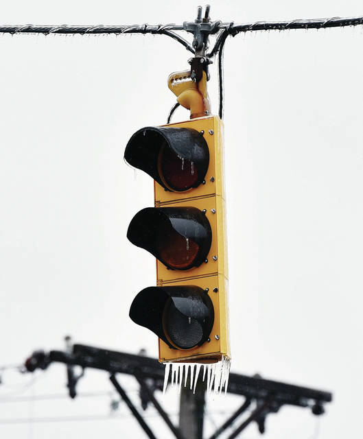 A stop light sits unlit at the intersection of N West Street and West North Street Thursday, Nov. 15.