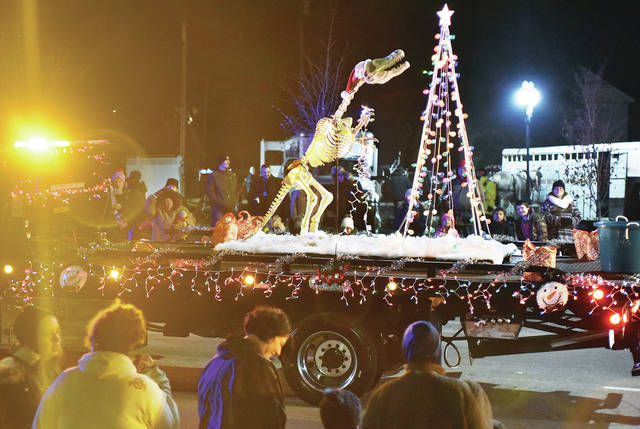 Perhaps one of the most creative floats in the Winter Wonderland Parade Friday, Nov. 16, was of a T-Rex skeleton wearing a Santa hat decorating a Christmas Tree. The T-Rex's mouth opened and closed and its eyes would glow red. The float was made by Wreckers Towing & Transport. The parade began after a tree lighting ceremony on the courtsquare.