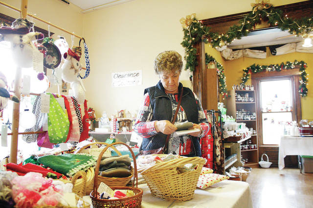 Jean Michael, of Sidney, looks at craft items during the 2016 Angels in the Attic craft show at the Ross Historical Center. This year's show opens Wednesday, Nov. 7.