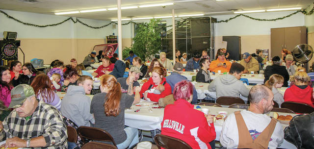 The Alpha Community Center Thanksgiving meal drew a packed crowd Friday, Nov. 16.