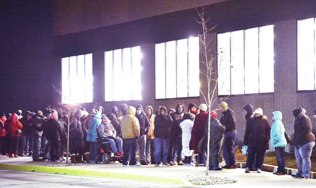 A line of people stretches along the side of Menards at 5 a.m. Friday, Nov. 23 waiting for doors to open so they can get Black Friday deals.