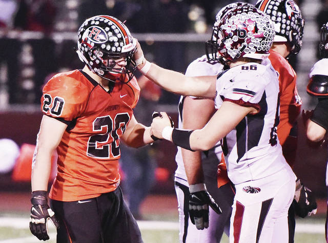 Fort Loramie's Max Hoying shakes hands with McComb's Tristan Sherick after Fort Loramie fell to McComb in the Division VII state semifinal on Saturday at Wapakoneta's Harmon Field.