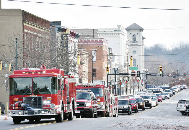 Fire trucks lead the funeral procession for Sidney firefighter Lt. Tony McLain as it moves toward Fire Station 1 Wednesday, Nov. 28.