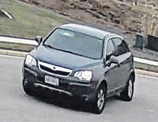 Camera footage shows the dark colored Saturn Vue police believe a man was driving who allegedly stole a package off of the front porch of a Fort Loramie residence Wednesday, Nov. 14, around 2:30 p.m. He is suspected in connection with fraudulent credit card activity and other charges. Call 937-295-4042 to report information.