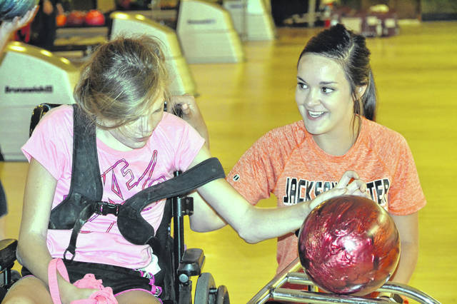 Abigail Berner, left, of Anna, and her provider, Katelyn Seger, of Fort Loramie, participate in a bowling day field trip during the Shelby County Arc Summer Recreation Camp 2018.