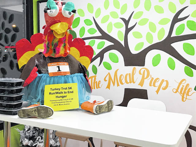 "Tootie the Traveling Tutu'd Turkey was recently seen at a new business in town. ""The Meal Prep Life"" owner Julie Casiano encouraged Tootie to order clean and healthy meals to go, in order to stay healthy before the big race this week. To register for the Turkey Trot 5K Race to End Hunger in Shelby County, go to www.sidneyfirstpres.org today! Tootie's been watching the weather, and it's going to be beautiful!"