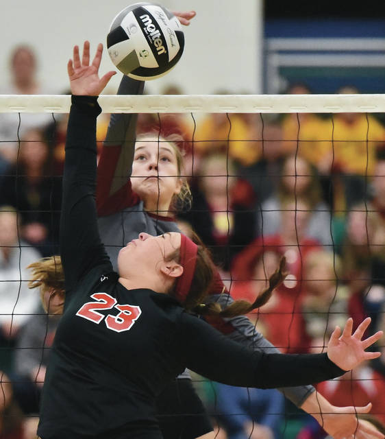 Fort Loramie's Aleah Frilling and New Bremen's Josie Reinhart battle at the net during a Division IV regional semifinal on Thursday at Northmont's Thunderdome.