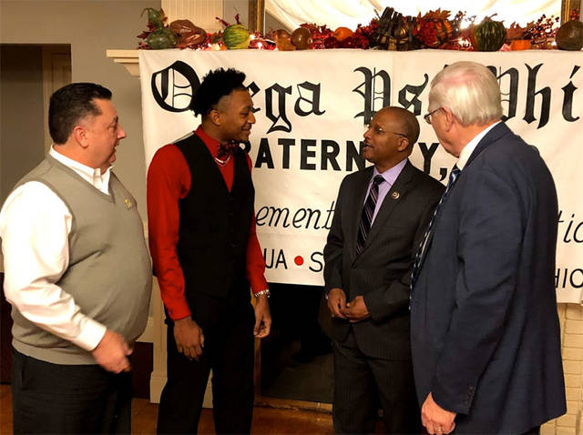Award winner Ratez Roberts, 17, of Sidney, second from left, talks with, from left, Sidney City Schools Superintendent Bob Humble, guest speaker Daniel B. Jones Sr., of Washington, D.C., and Sidney Mayor Mike Barhorst during the Achievement Week Celebration of the Xi Iota Iota Chapter of Omega Psi Phi Fraternity at the Piqua County Club, recently.