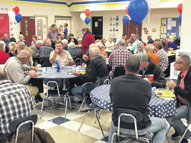 Military veterans enjoy lunch at Russia Local School, Wednesday, Nov. 7.