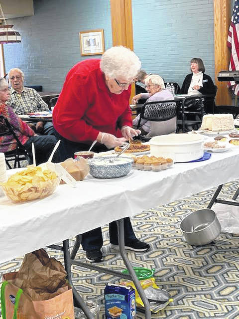 Lois Nagel, of Anna, cuts some pie for dessert during the membership meeting luncheon of the Senior Center of Sidney and Shelby County, at the center in Sidney, Nov. 13.