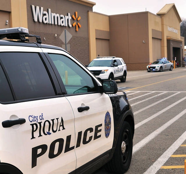 Law enforcement units from Piqua and surrounding agencies respond to the Piqua Walmart on Monday afternoon on the report of shots fired. In addition to the Piqua Police Department, units from the Miami County Sheriff's Office, the Ohio State Highway Patrol, and Troy Police Department responded to the incident.