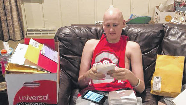 Jackson Hogenkamp opens Christmas cards collected by classmate Gabrielle Wehrman. Hogenkamp is currently battling Osteosarcoma. Wehrman has already collected nearly 3,000 cards for Hogenkamp.