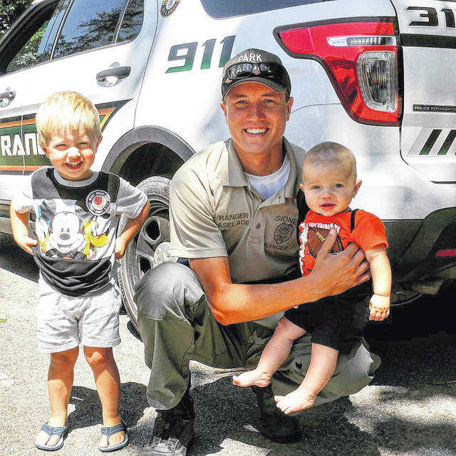 Ranger Jason Aselage poses with his sons Carson (on his lap) and Gabriel in Tawawa Park earlier this year.