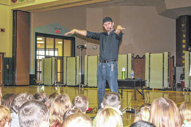 Dr. Blake Brandes, of Berkeley, Calif., talks about perseverance with students at Anna Elementary School, Monday, Dec. 18. The school's theme this year is Grit and Perseverance.